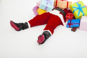 Santa on ground with holiday packages and gift cards