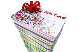 Tall stack of holiday gift cards with bow on top