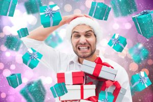 Man frustrated with holiday packages gift card falling around him