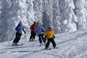 Kids skiing down hill for winter fun