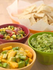 avocados in different dips with chips