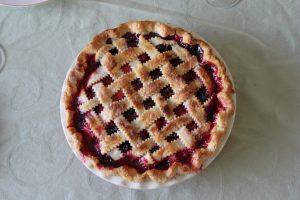 Cherry pie on dinner table with lattice crust