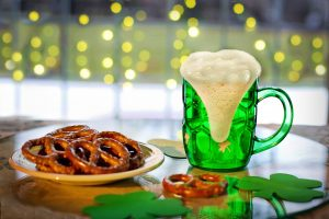 green draft beer and pretzels for st. Patrick's day