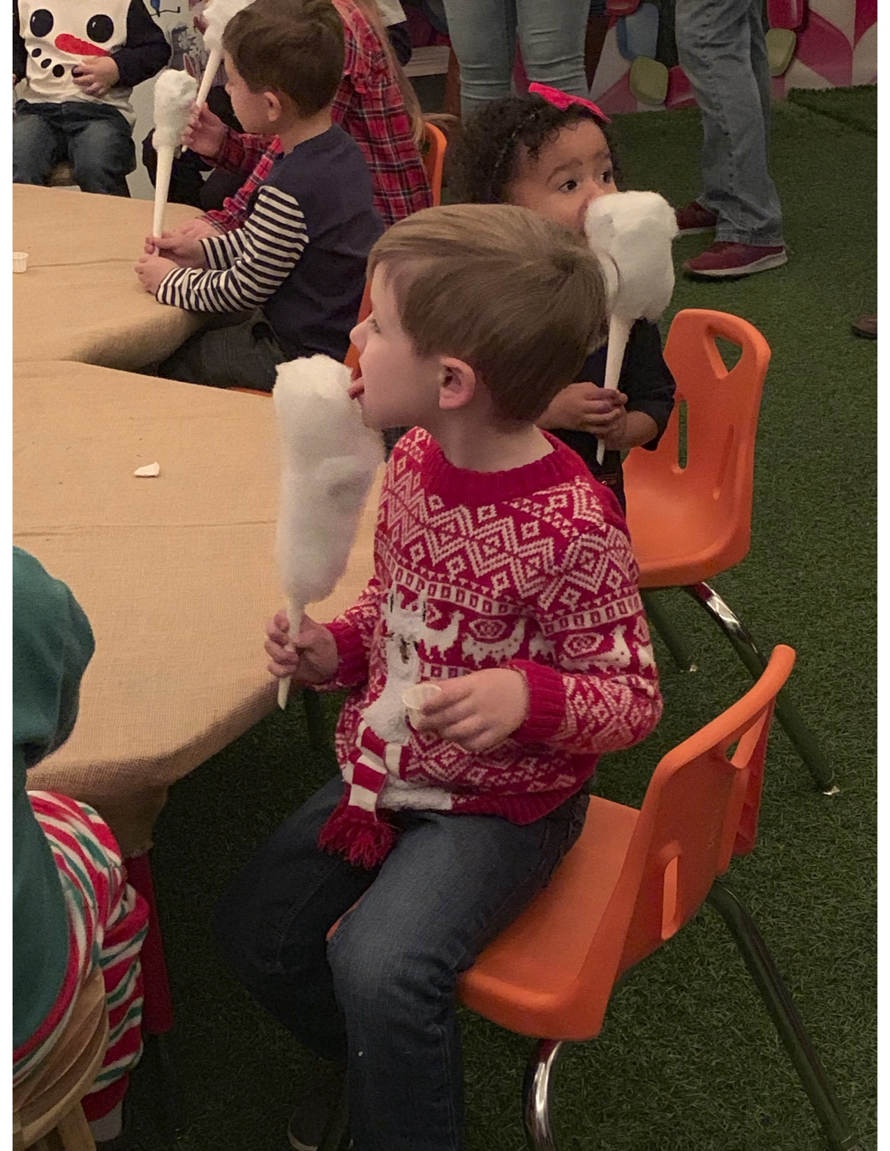 boy eating cotton candy at Holiday event