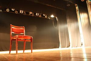 red chair on theater stage broadway