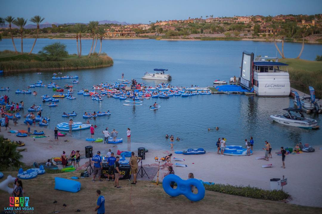 Lake Las Vegas Water sports giant movie screen in the water with people in tubes all over