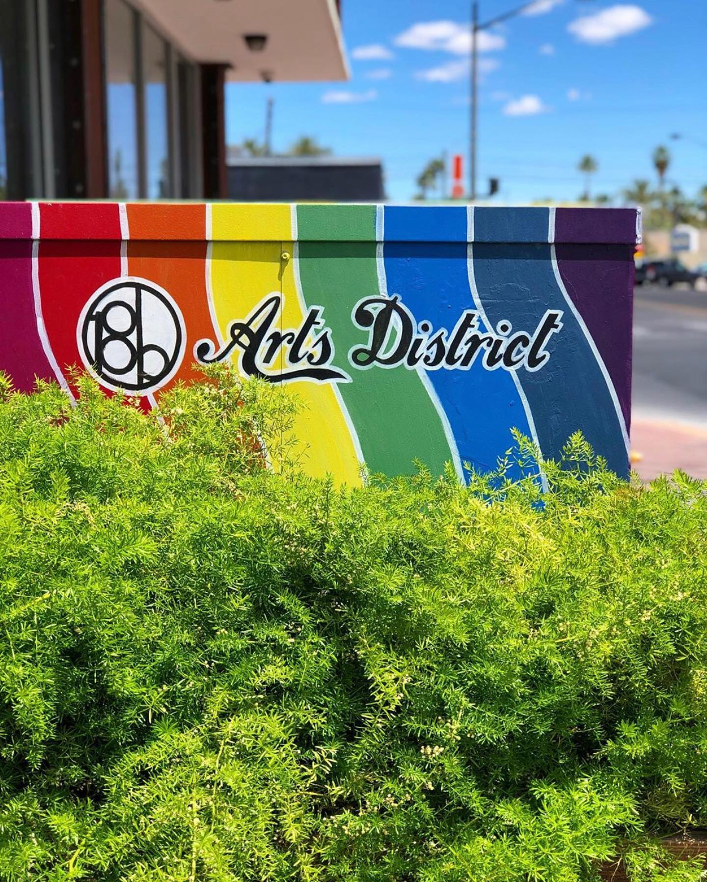 first fridays Arts District sign in multiple colors