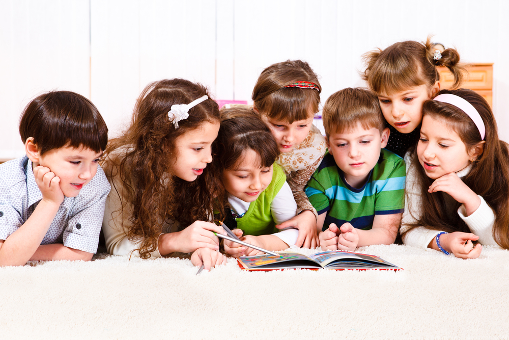 Story time online, kids reading a book together