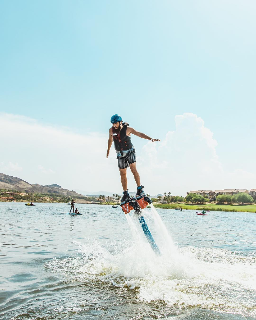 Lake Las Vegas Water Sports flyboard, man shooting out of water with jetpack under his feet.