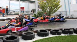 Mini go cart track with drivers in colorful carts