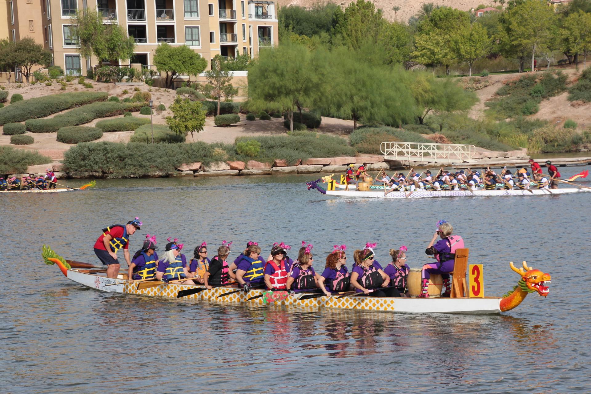 two long dragon boats on the water at Lake Las Vegas
