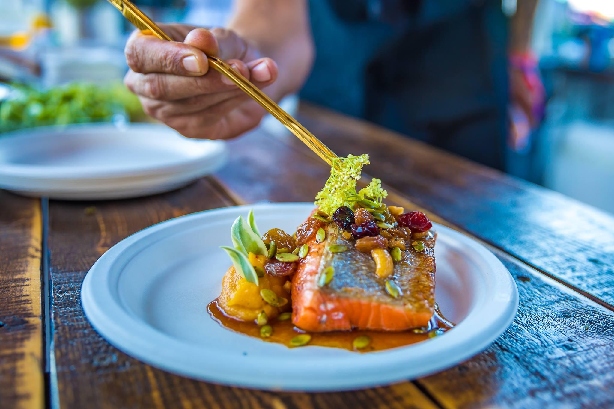Life is Beautiful food option, ahi tuna on a plate, someone eating with chopsticks