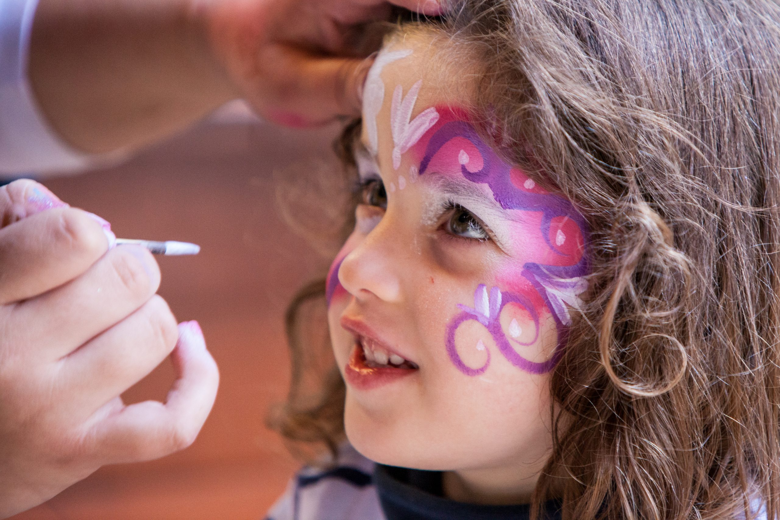 face painting on girl, spring break at home activities