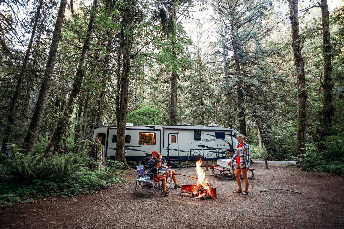 RV camper and family in forest